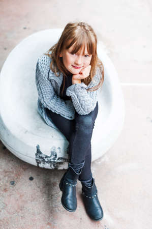 7 8 years: Outdoor portrait of adorable little girl in a city Stock Photo