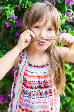 puckering lips: Close-up portrait of a cute little girl at summer vacation