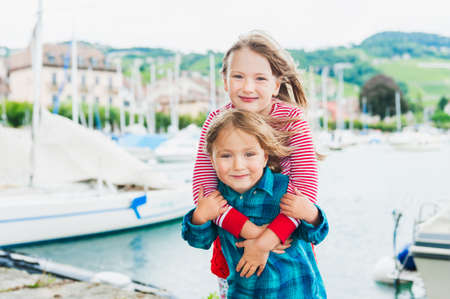 Outdoor portrait of adorable children on a very windy day