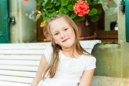 little girl posing: Outdoor portrait of a cute little girl Stock Photo