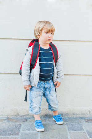 kindergarden: Outdoor portrait of a cute toddler boy, going to kindergarden with backpack Stock Photo