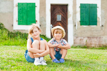 outside outdoor outdoors exterior: Adorable children resting in a countryside Stock Photo
