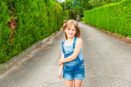 seven years: Summer portrait of a cute little girl of seven years old