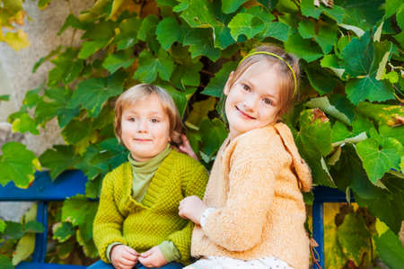 pullovers: Adorable children resting outdoors, wearing knit pullovers