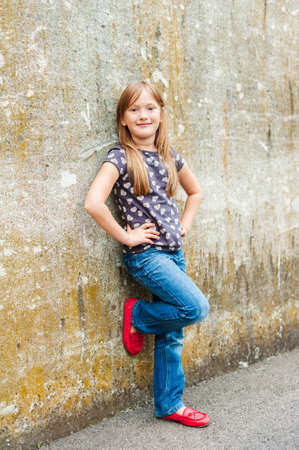 moccasins: Outdoor portrait of a cute little girl wearing red moccasins