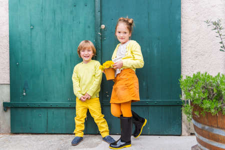 fashion: Outdoor portrait of adorable fashion kids, wearing yellow clothes