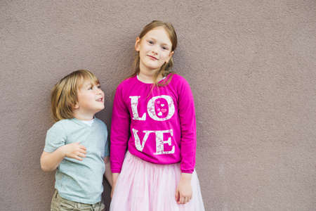 Outdoor portrait of adorable kids little girl and boy