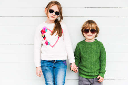 pullovers: Fashion kids outdoors wearing pullovers and sunglasses