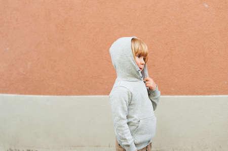 alone boy: Fashion portrait of adorable toddler boy wearing grey sweatshirt