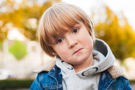 sad cute baby: Close up portrait of a sad toddler boy Stock Photo