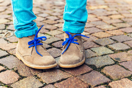 trendy: Fashion shoes on kids feet Stock Photo
