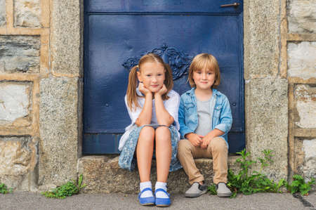 sister: Outdoor portrait of a little girl and her brother Stock Photo
