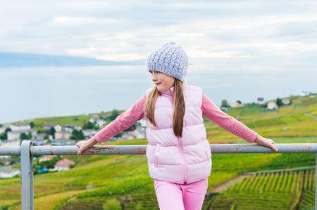 admire: Kid girl standing between Lavaux vineyards, admire amazing view