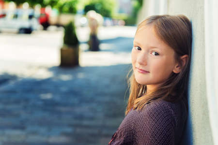 8 years: Outdoor portrait of a cute little girl of 8 years old