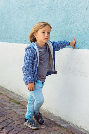 knitted jacket: Outdoor portrait of adorable little boy wearing blue knitted jacket Stock Photo