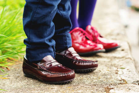moccasins: Two pairs of kids feet wearing fashion shoes