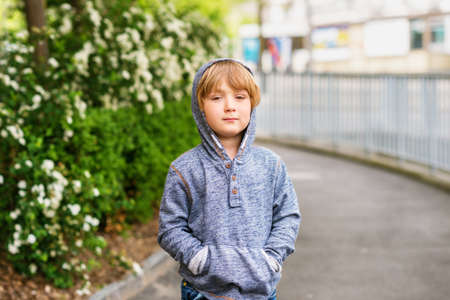45 years old: Fashion portrait of adorable little boy of 4-5 years old wearing blue sweatshirt