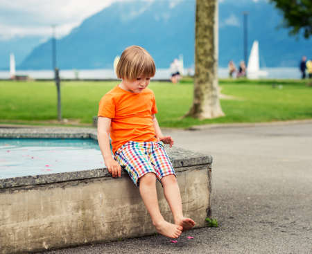 45 years old: Cute little boy of 4-5 years old playing in fountain on a nice summer day