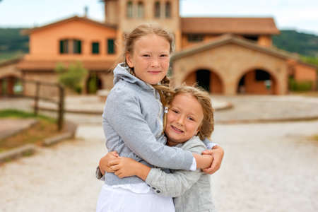 very windy: Two adorable kids playing outdoors on a very windy day. Image taken in Tuscany, Italy