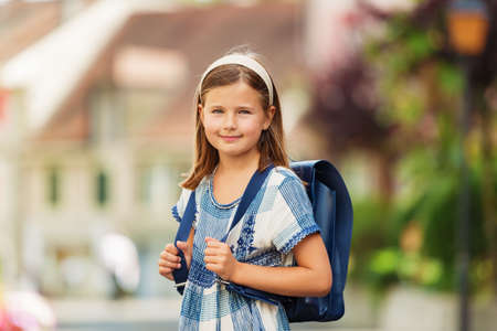 9 year old: Pretty little 9 year old girl walking back to school Stock Photo