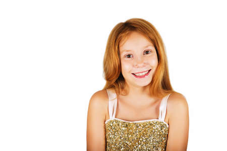 9 year old: Studio shot of adorable little 9 year old girl with red hair