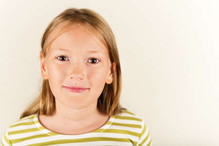 9 year old: Studio shot of adorable little 9 year old girl Stock Photo