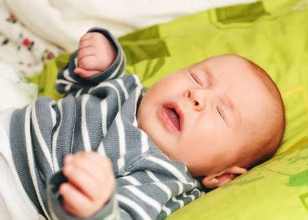 Sneezing newborn week-old baby Archivio Fotografico