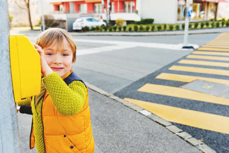 carriageway: Cute little boy crossing the road alone Stock Photo