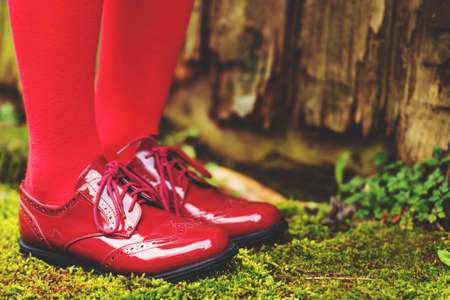 brogues: Fashion modern red shoes on kids feet Stock Photo