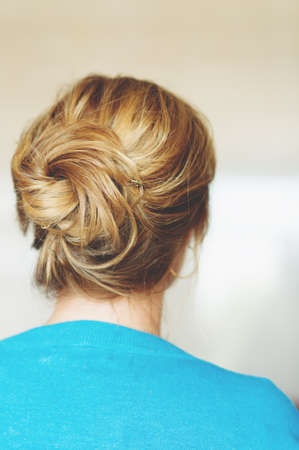 Back view of beautiful hairpiece style, blond hair