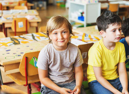 Two concentrated 5-6 year old boys in classroom