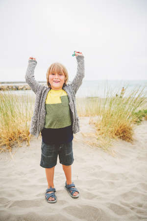 camargue: Little boy enjoying summer vacation by the sea. Image taken in Saintes-Maries-de-la-Mer, capital of Camargue, south of France Stock Photo