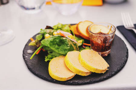 Foie gras salad with fig confiture served in the restaurant