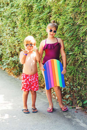 swimsuite: Funny kids on summer vacation, wearing swim suits and sunglasses