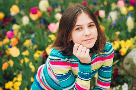 Outdoor portrait of young preteen 12 year old girl