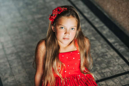 Portrait of young girl model wearing red dress Reklamní fotografie