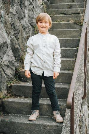 Outdoor fashion portrait of handsome kid boy