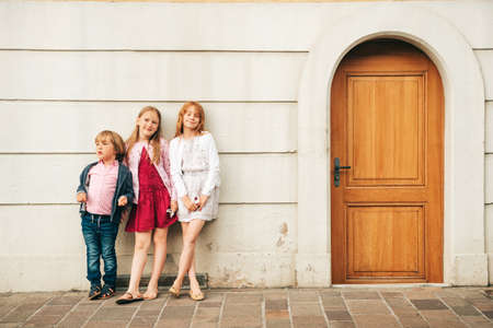 Outdoor portrait of 3 funny kids, fashion for children Stock Photo