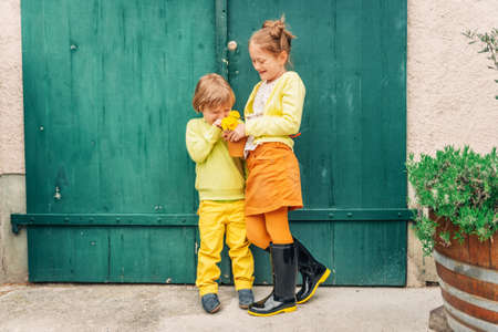 Outdoor portrait of adorable fashion kids, wearing yellow clothes