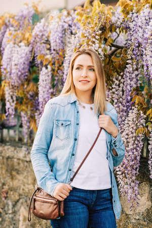 Spring portrait of elegant young woman wearing denim shirt