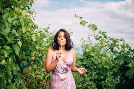 Summer portrait of happy young woman hiking in vinyards Stock Photo