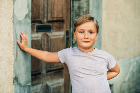 Outdoor portrait of handsom little boy with new haircut