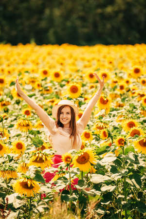Outdoor portrait of beautiful young woman with sunflowers, health and lifestyle