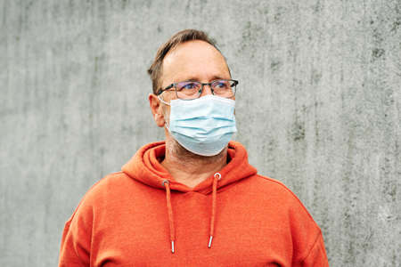 Middle age man wearing medical facial mask