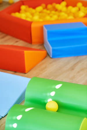 Playroom in kindergarten, sport center in day care, ball pool and colorful mats Foto de archivo