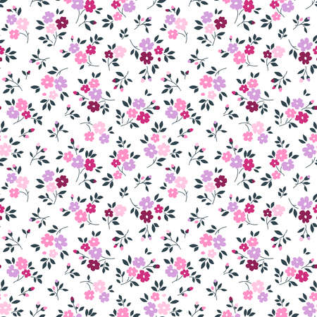 Elegant floral pattern in small lilac and pink flowers. Liberty style. Floral seamless background for fashion prints. Ditsy print. Seamless vector texture. Spring bouquet. 矢量图像