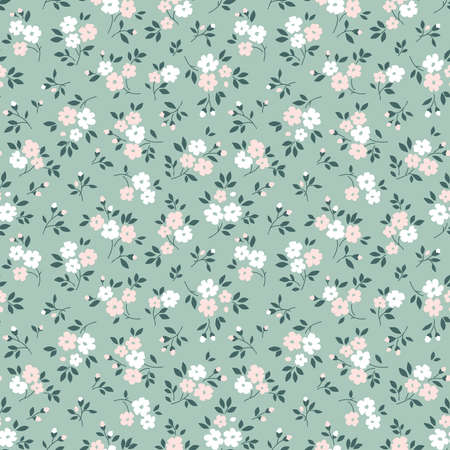 Elegant floral pattern in small pale pink and white flowers. Liberty style. Floral seamless background for fashion prints. Ditsy print. Seamless vector texture. Spring bouquet. Çizim