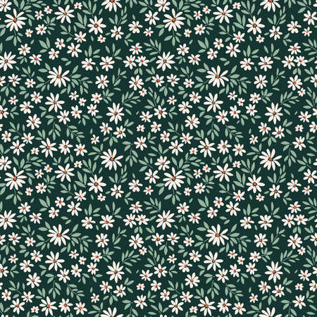 Simple cute pattern in small white flowers on dark green background. Liberty style. Ditsy print. Floral seamless background. The elegant the template for fashion prints.