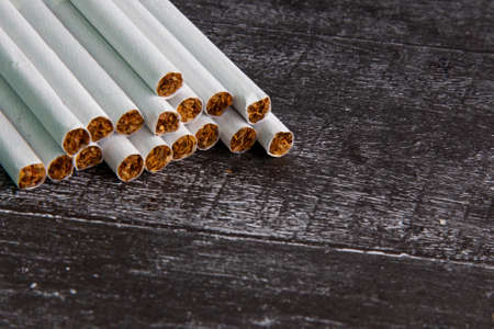 Close-up of a Smoking cigarette on a dark background. Crushed tobacco leaves in cigars. Bad habit