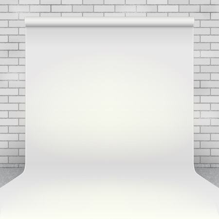 Empty white paper photo studio backdrop in room with white brick wall and concrete floor Ilustrace
